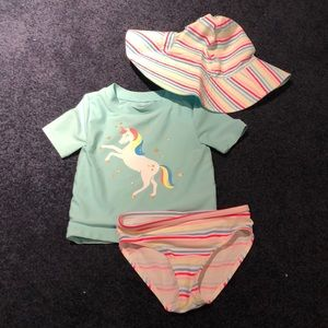 Gently used carter's bathing suit with hat